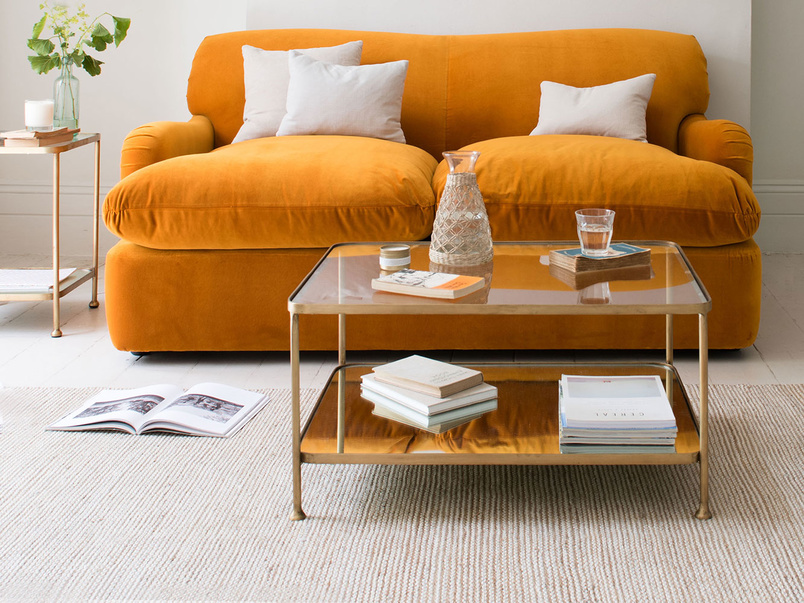 A beautiful trio of Brass, Glass and Mirror make up the Wonderboy Coffee table via Made.