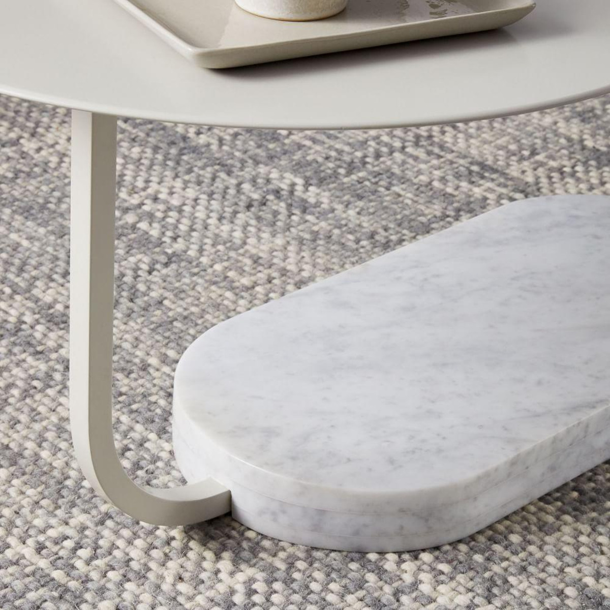 With its solid marble base and lacquered top, it's a streamlined piece that also works well in smaller spaces. - West Elm