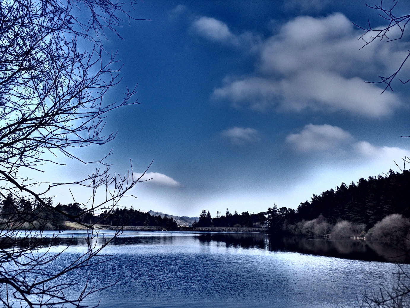 The radiant blue of a Dartmoor winter sky reflected in the waters of Venford Reservoir.