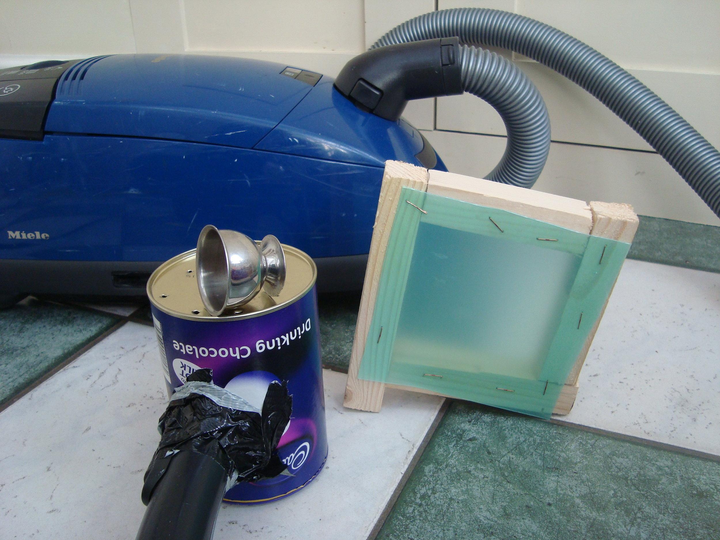 Improvised vacuum former using a vacuum cleaner.