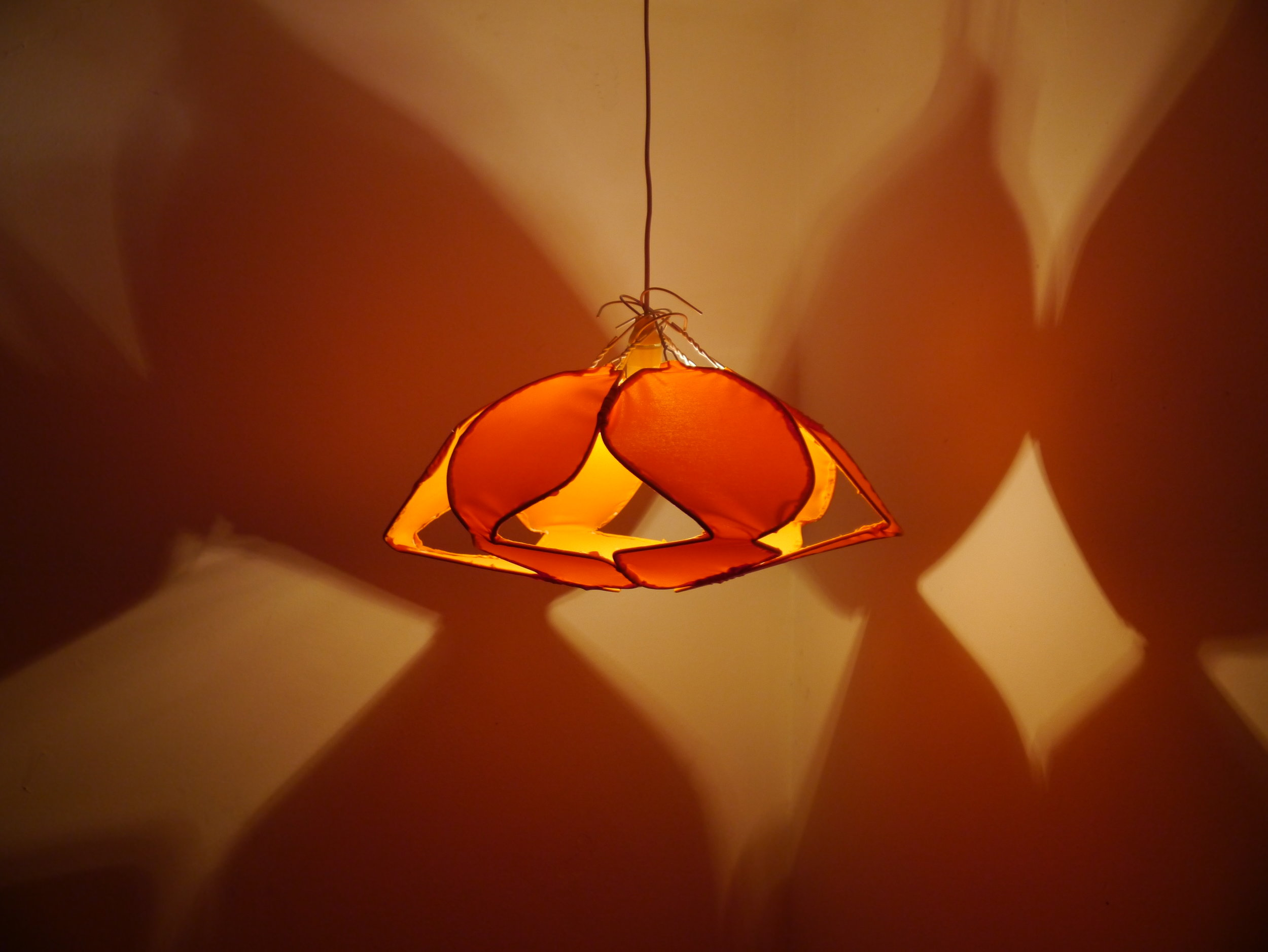 Lotus lampshade from metal hangers and nylon fabric.