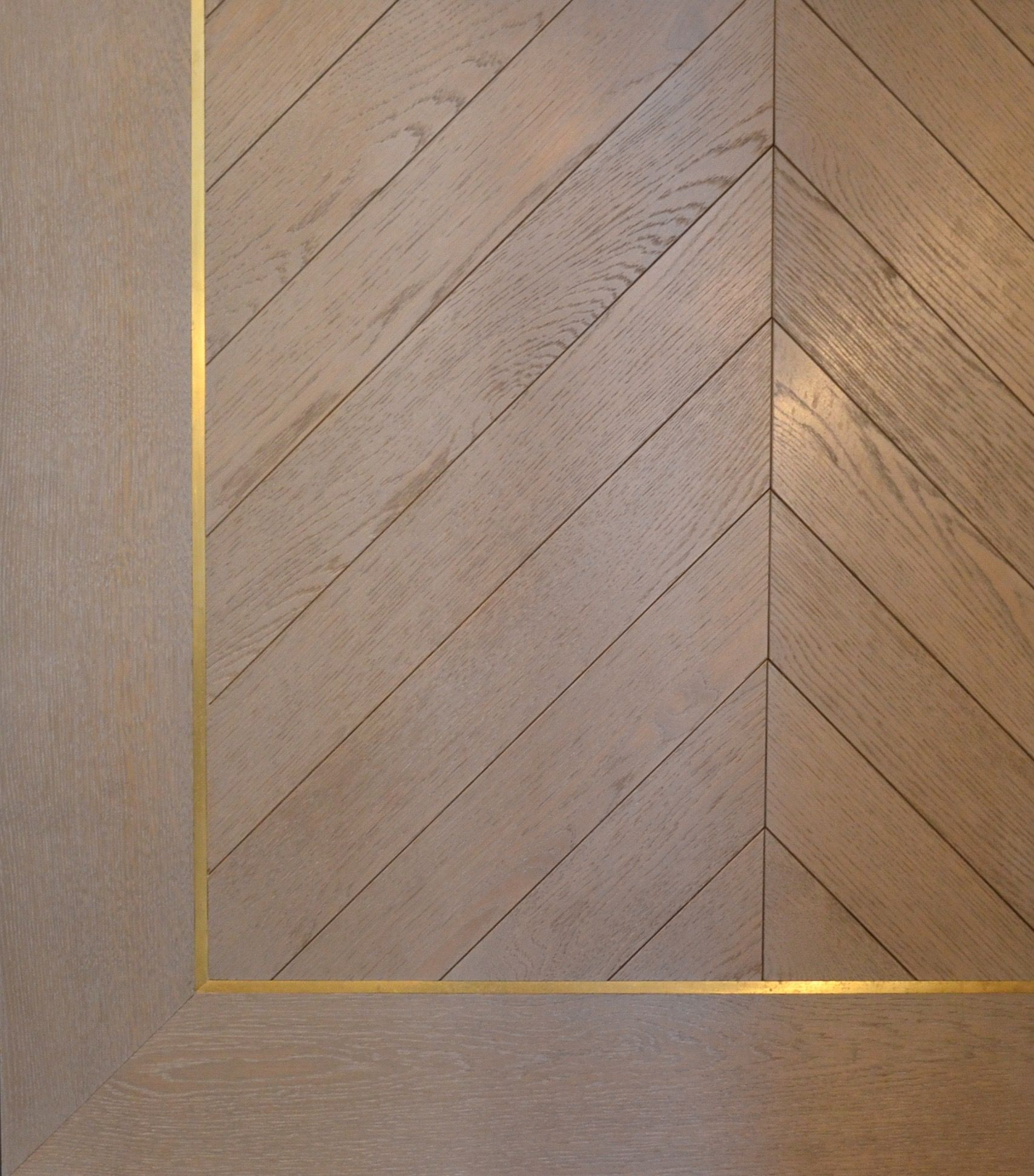 Oak Chevron Flooring with brass inlay