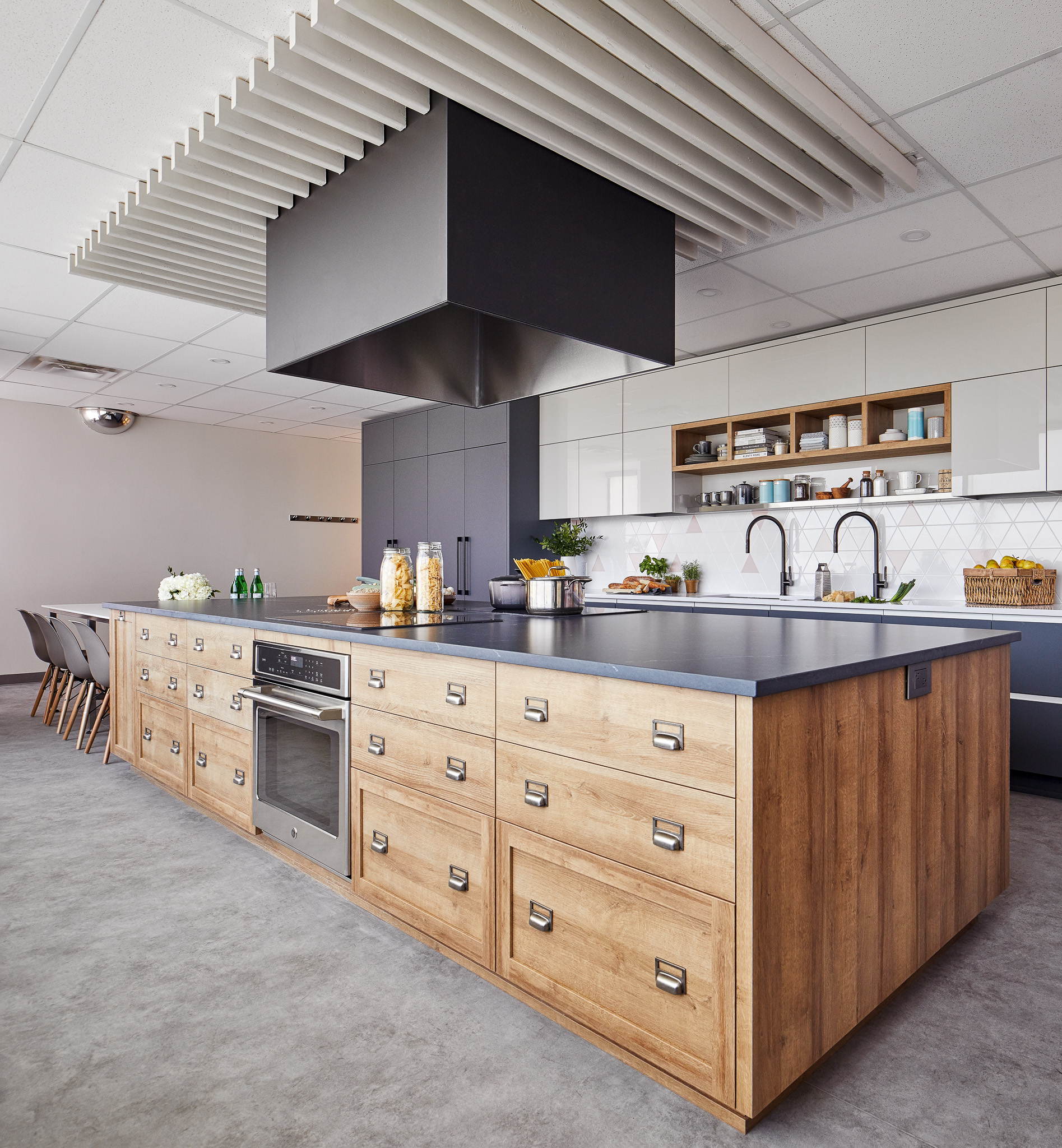 New kitchen offers a lot of storage, doubles of all appliances and a generously sized island with plenty of counter surface to facilitate usage of the kitchen by large groups.