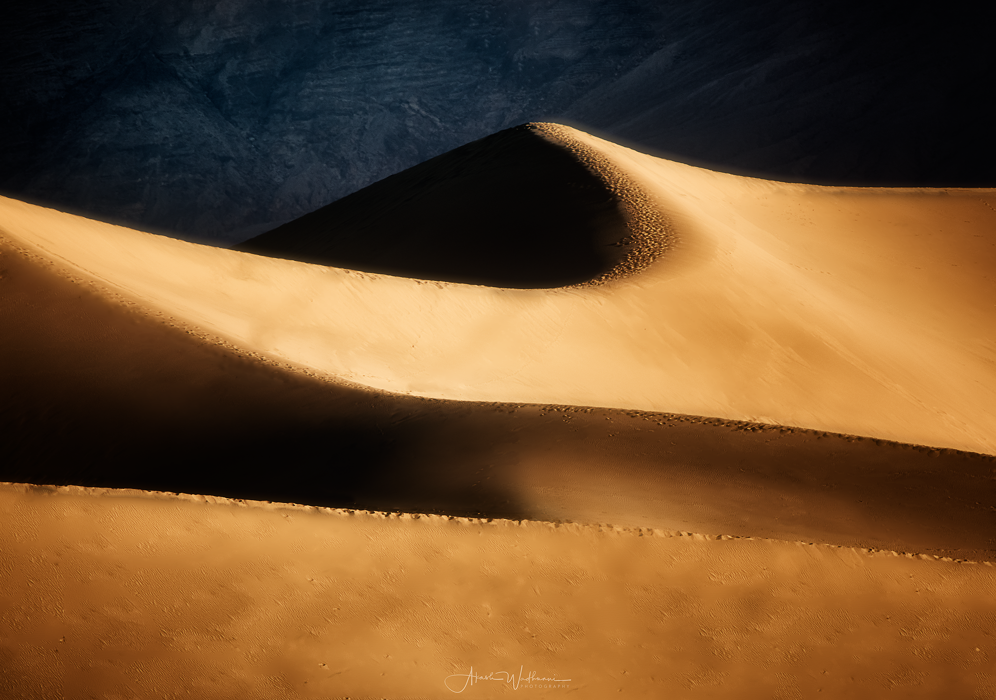 Sunrise brings the largest dune, known as Star Dune, fresh drama. A7rii 900mm F8