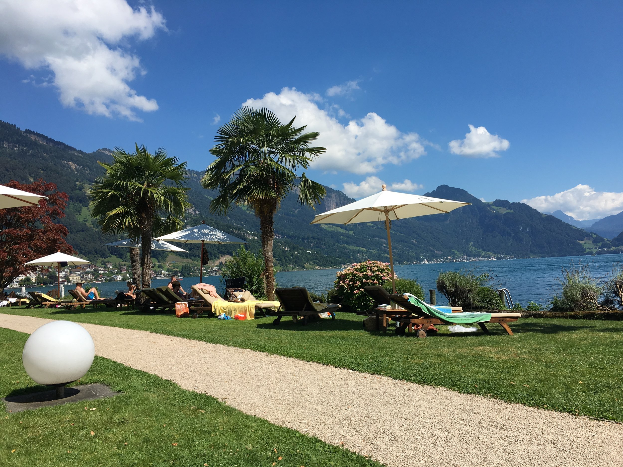 The palm trees suggest that we are South of the Alps, but the water temperature will tell you otherwise...