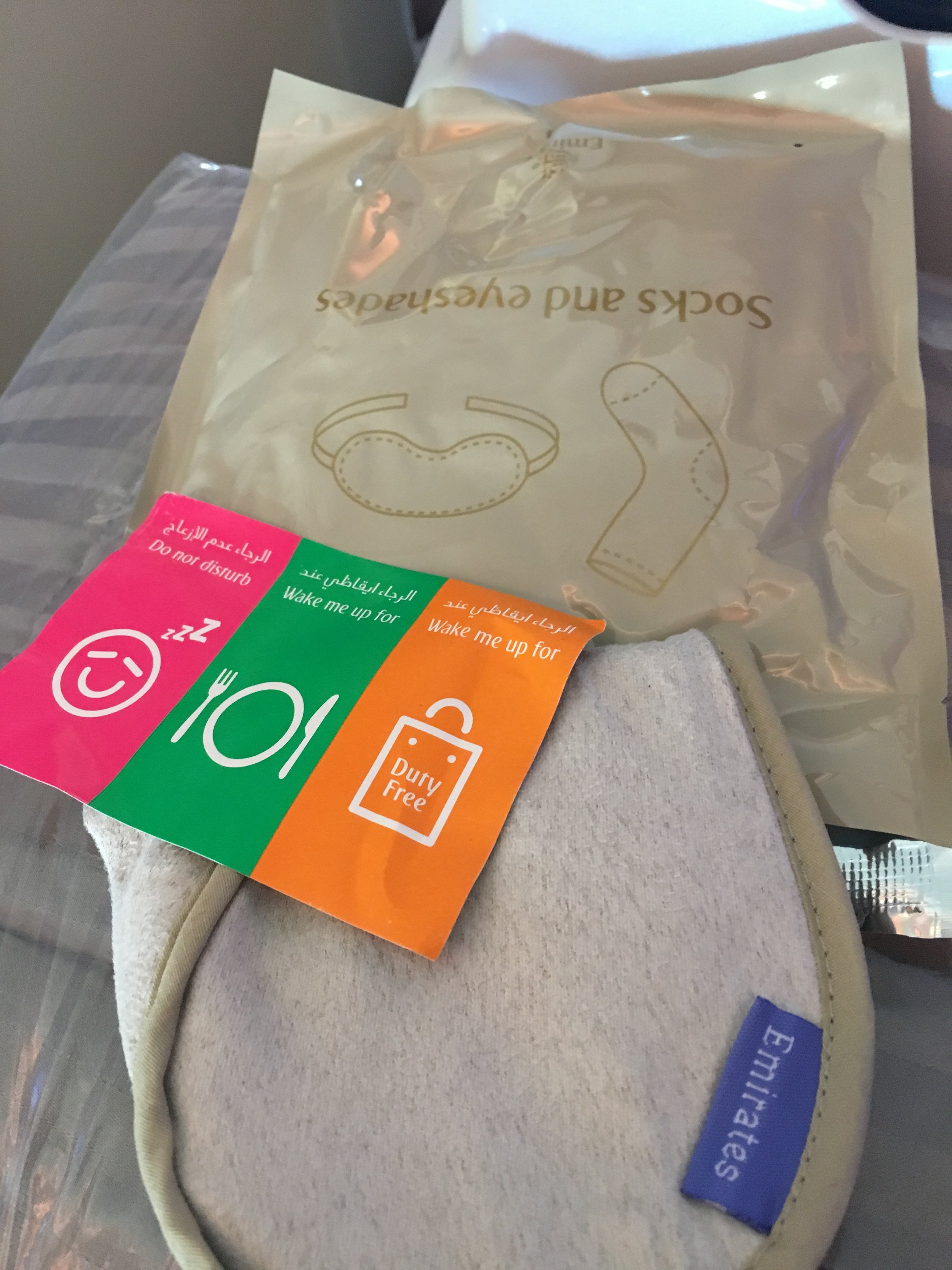 """The three stickers for the top your seat to tell the FA how you want to be """"treated"""" today. Also socks and eyeshades in a plastic bag - rather than an amenity kit."""