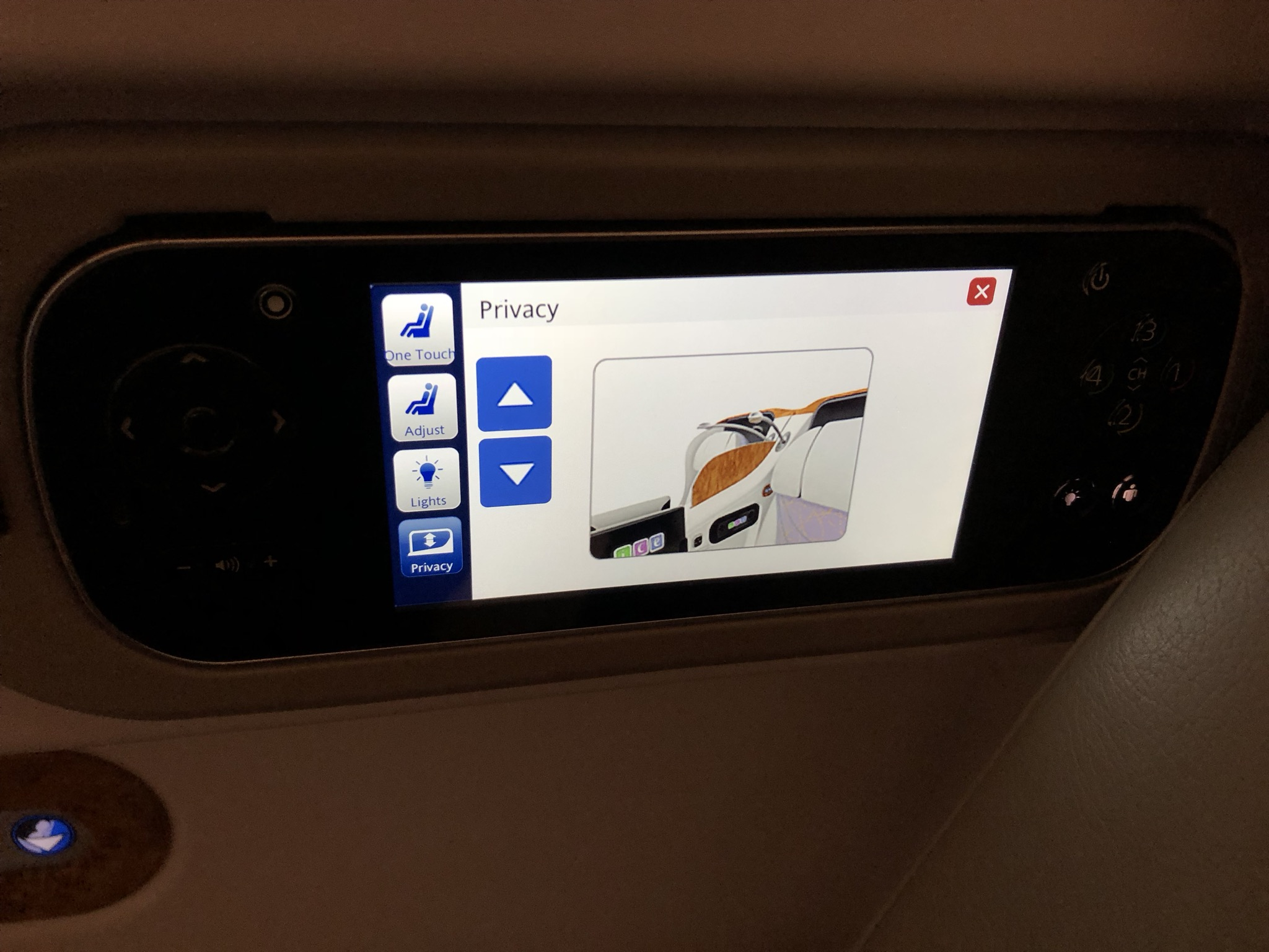 Remote control with touch screen to control seat functions and the IFE
