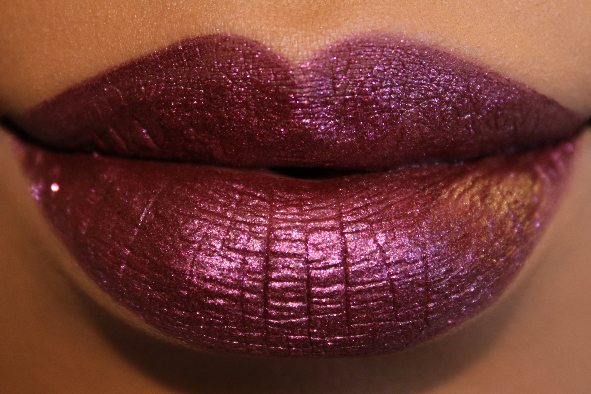 Urban Decay Liquid Lipstick in Purgatory Candy Coated Clsets.jpg