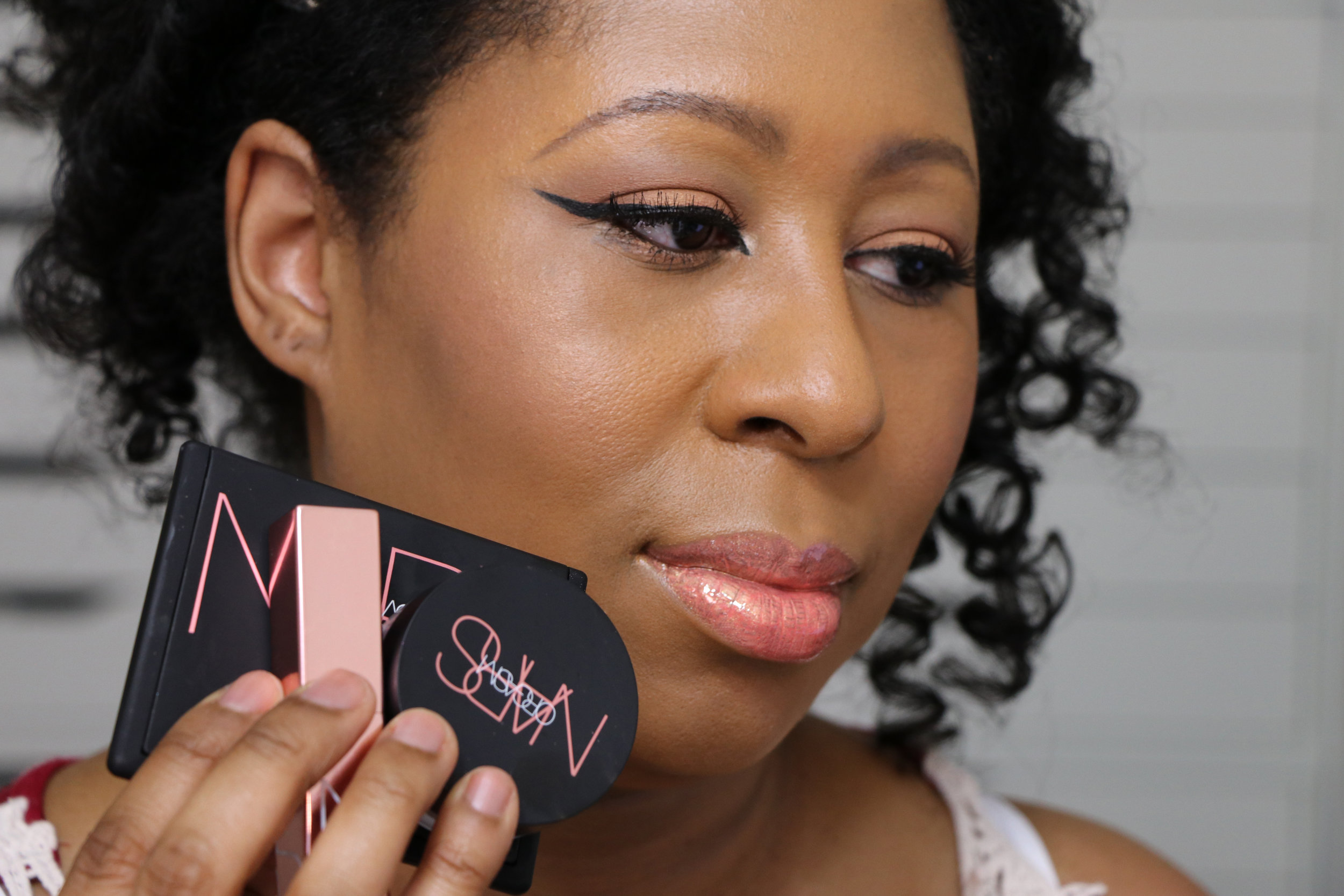 Wearing the Lip Lacquer, the Blush and the Illuminating Loose Powder.