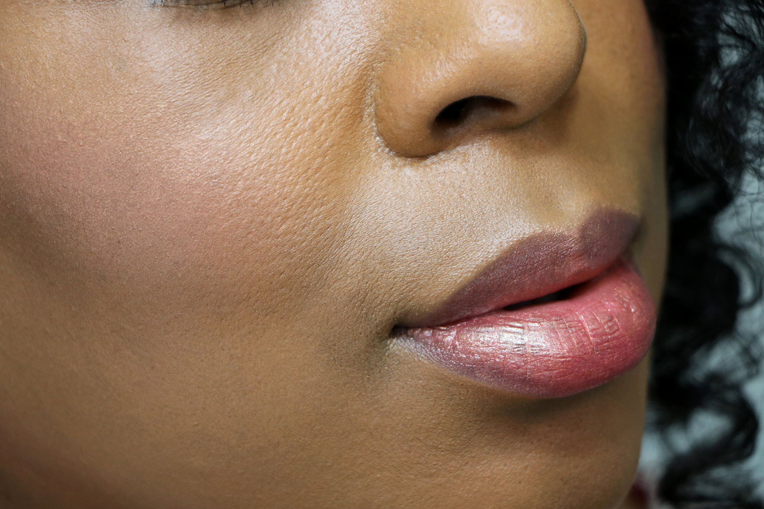 Wearing the Orgasm Blush, the lip balm and the Illuminating Loose Powder over the lip balm.