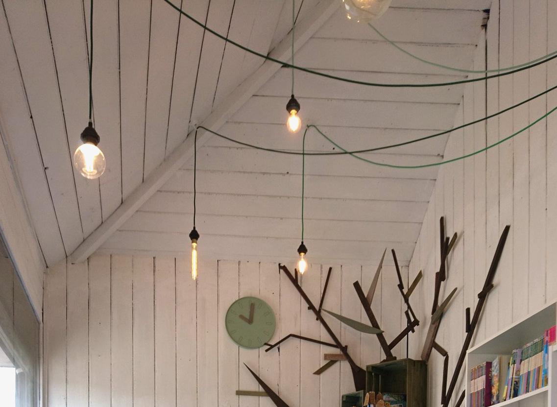 Through the Wardrobe Childrens Bookshop interior design lighting