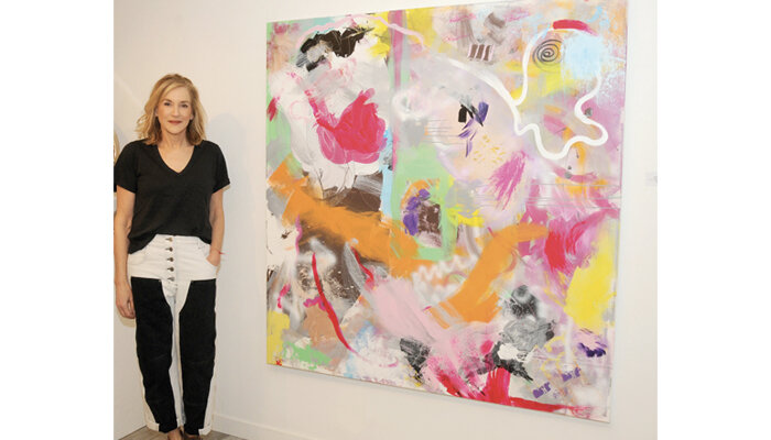 Joanne Handler with her painting at The White Room Gallery in Bridgehampton, NY.