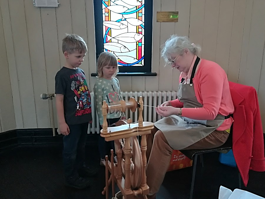 Gillian Thomas brought her spinning wheel and happily demonstrated how to spin wool for knitting