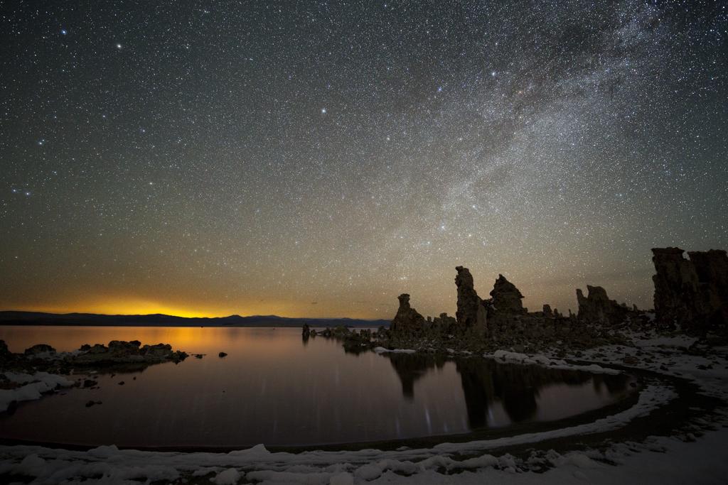 The Milky Way crosses the nighttime sky over Mono Lake