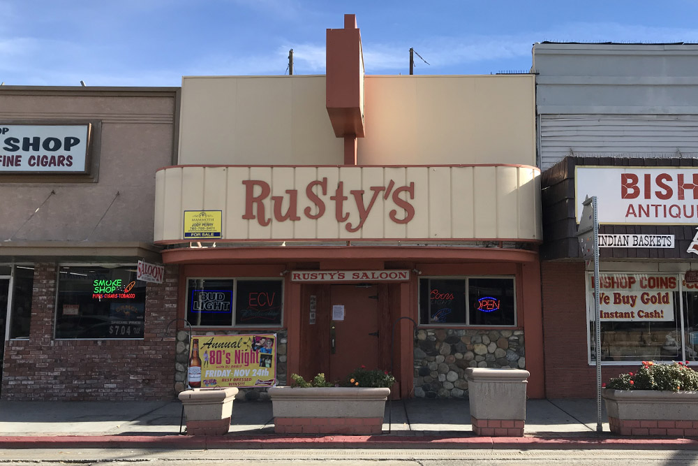 Rusty's Saloon is your classic dive bar with pool, suffleboard, darts, and good beer selections.