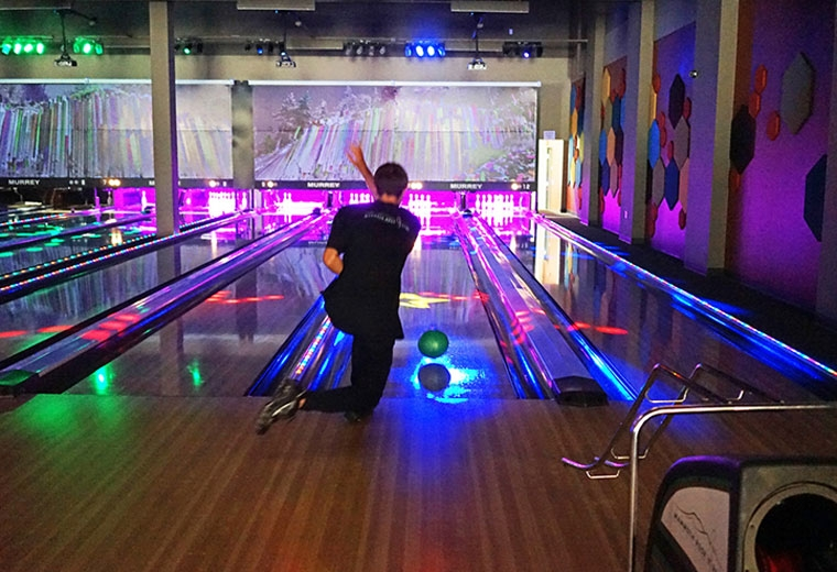 Mammoth Rock 'n Bowl offers great food, golf simulators, and of course bowling -- sometimes cosmic! ( mammothrocknbowl.com )