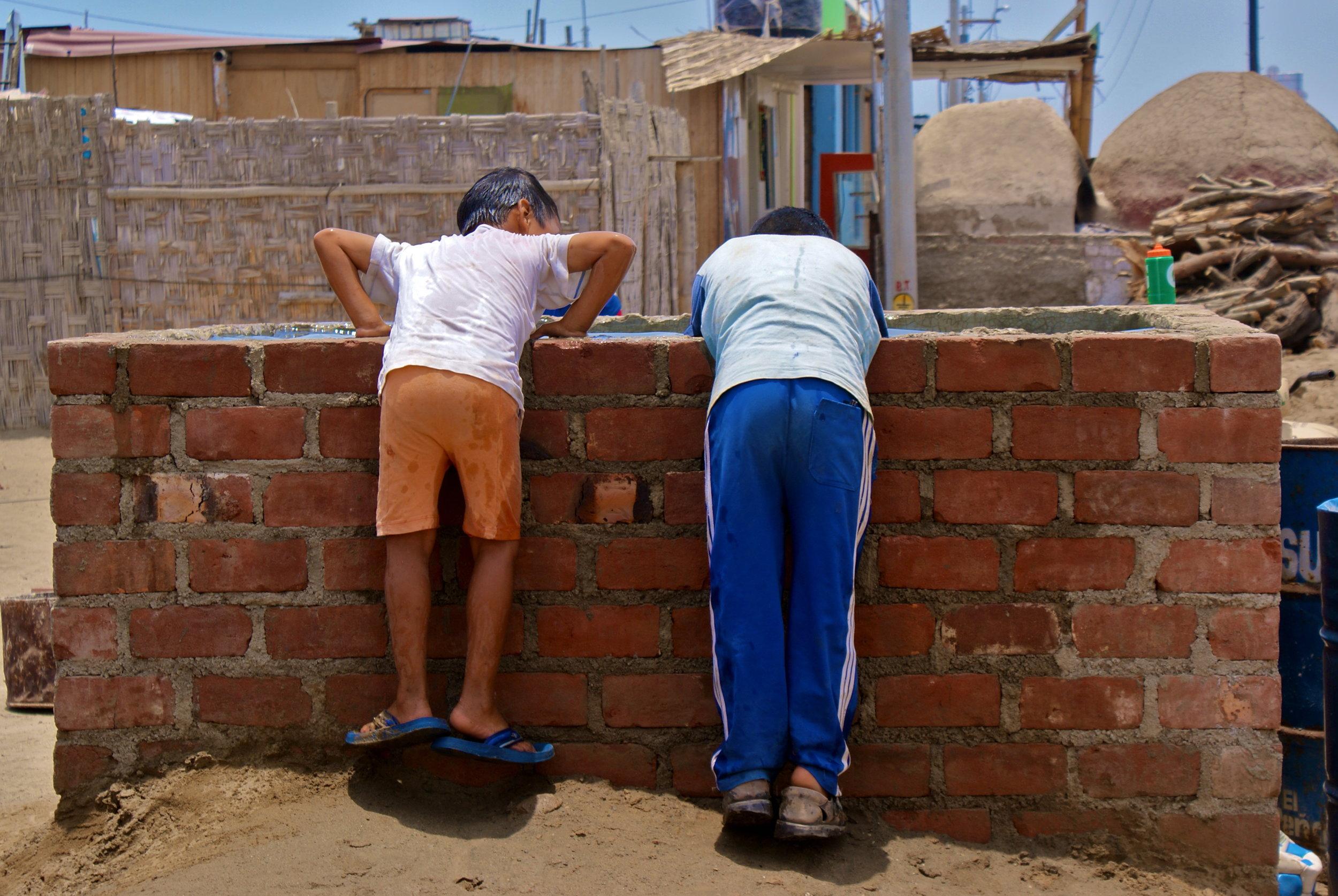 Watering_well_Peru.JPG