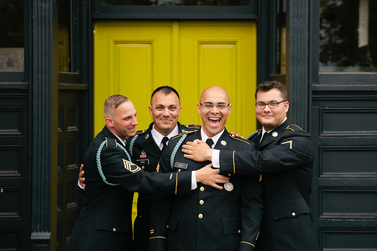 Groom and friends in military uniforms