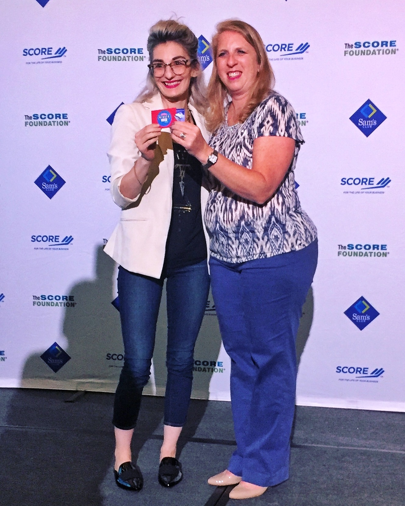Kyira Hauer (left) accepts her SCORE award at the 2017 American Small Business Championship.