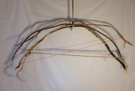 "3 Walking Bows   2015 · found sticks, found rope and strap · ~48""x60""x10"""