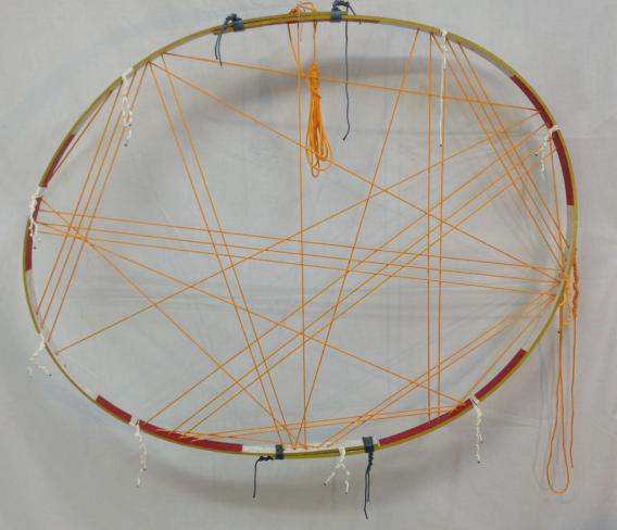 """PI, 33 digits traced to the first ZERO   2014 · found oak staves, crayon, nylon rope, dye · algorithmic knotting · 44""""x43"""""""