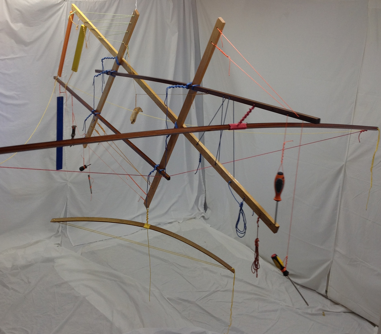 """Suspended animation   2014 · cypress, sapele, maple, spar varnish, crayon, nylon rope, dye, found tools · """"Cool-Breeze(TM)"""" fan · 96""""x106""""x60"""""""