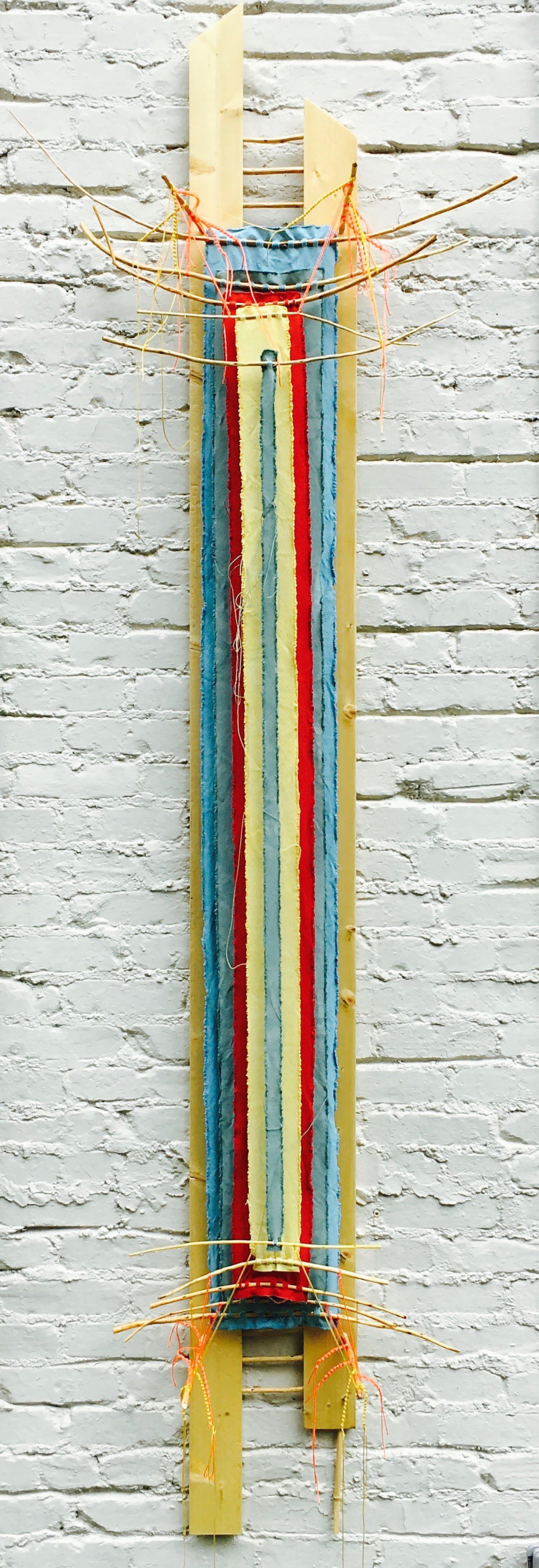 """Twin-entangled Stele, backward glance   2017 ·found board/sticks, cedar pegs, canvas, string, dye, varnish ·101""""x33""""x7.5"""""""