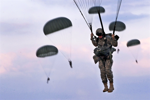 Army soldiers parachute from a C-130 Hercules Fort Bragg, NC - Sept. 12, 2010.jpg