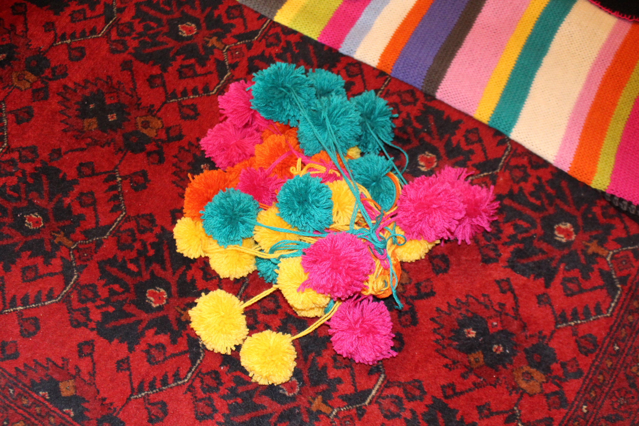 Get a friend to make some pom poms (thanks Merrie!) ...