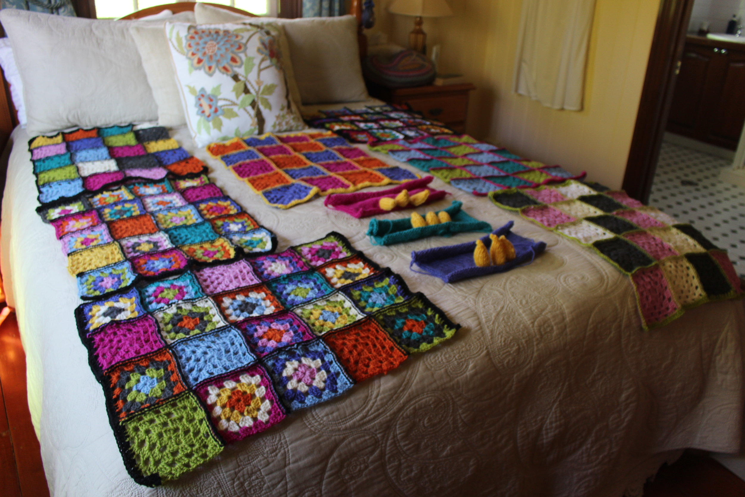 The crocheted squares are for the awning poles outside the cafe.