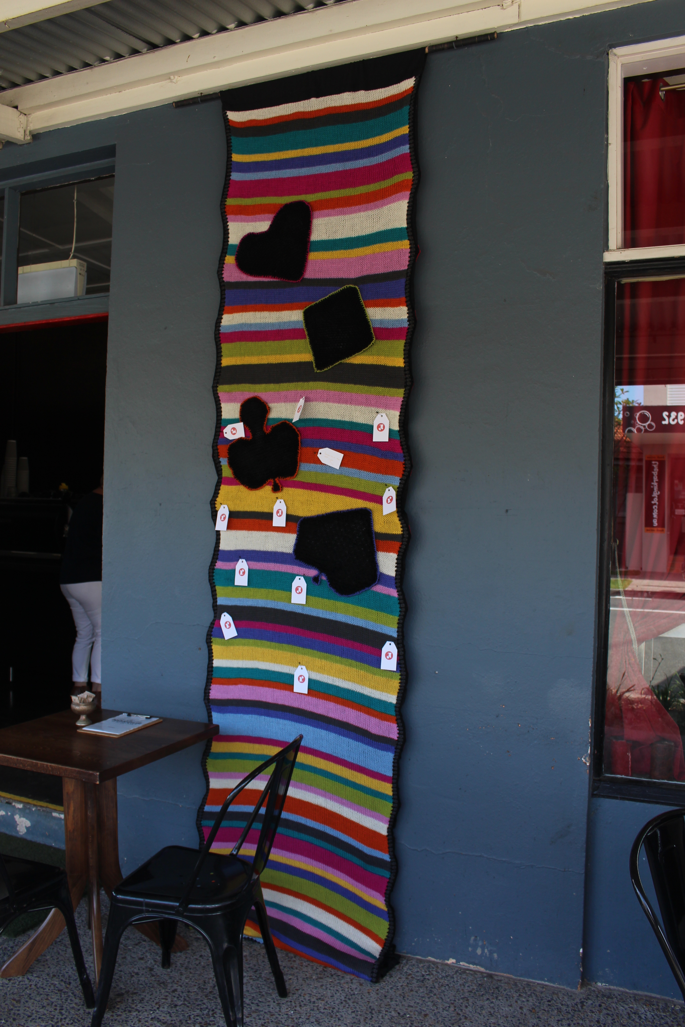The banner in place. I left cards and some gold pens for people to write messages to the cafe owners.