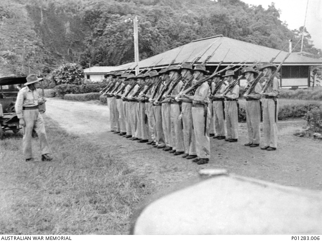 Salamaua, New Guinea, 1940-04-25. The Salamaua Platoon of the New Guinea Volunteer Rifles (NGVR) on parade, drilled by Sergeant Rogers. (Donor H. Walter) ID P01283.009, Australian War Memorial.