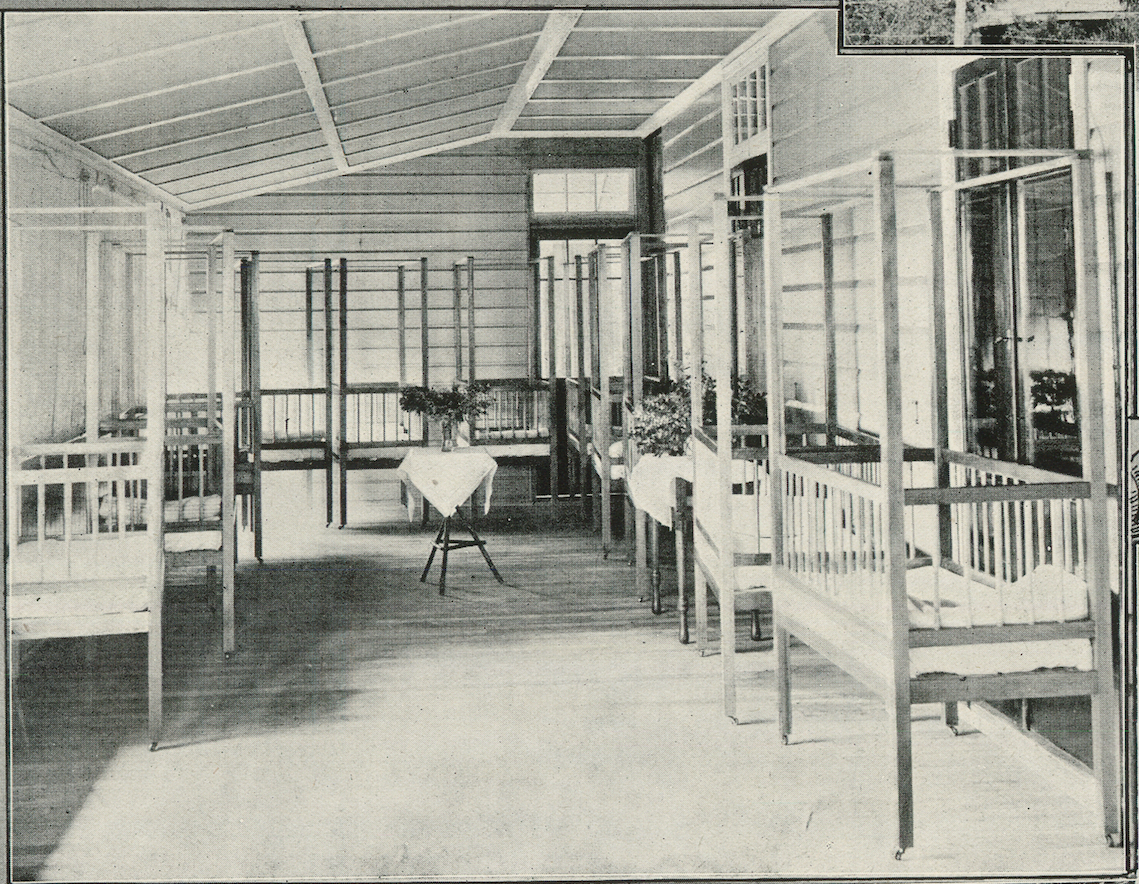 An interior view of Lynne Grove House in 1918, when it was the Corinda Infants' Home. This was one of the enclosed verandahs, used as a nursery.