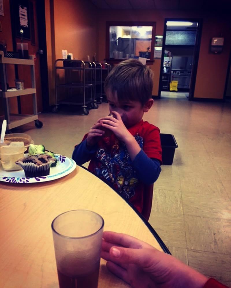 kid drinking farther away - daycare.jpg
