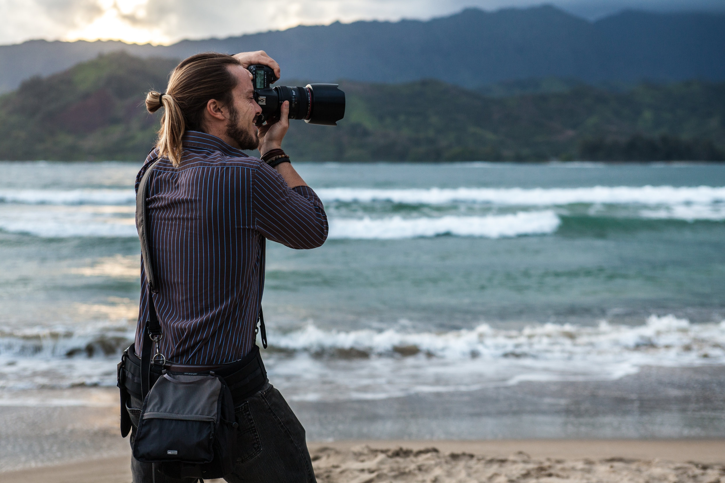 Michael Wheeler photographing on the beach.