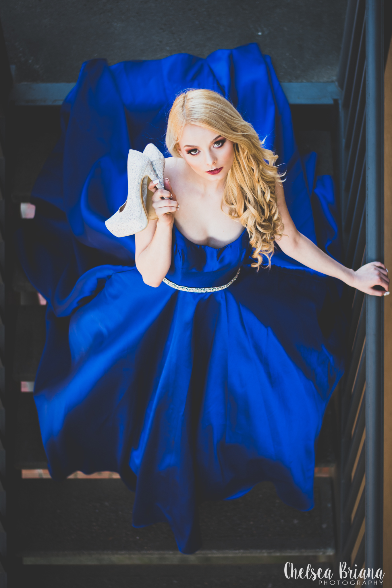model-wearing-blue-gown-on-staircase