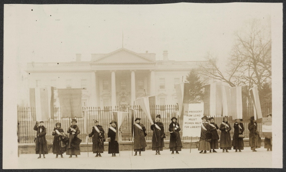 "Suffragists picketing in front of the White House in 1917. (Harris & Ewing/Library of Congress).  Learn more about ""Alice Paul's Enduring Legacy of Nonviolent Action."""