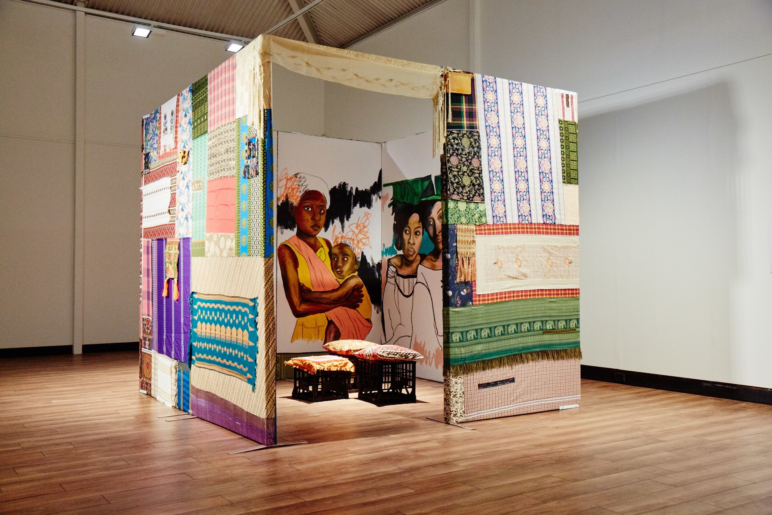 "Tahanan, 2019, timber, recycled fabric, canvas, paint, 240 × 260 cm, at ""Stomping Ground,"" Fairfield City Museum & Gallery, Smithfield, 2019.  Photo by Josh Morris Photography. Courtesy FCMG."
