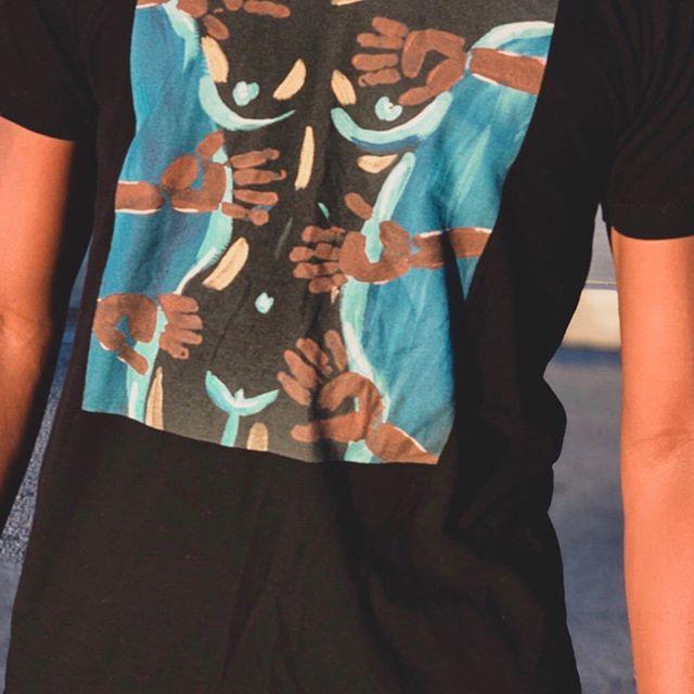 """Givers & Takers"" t-shirt features original work by Amber Luna @amberaluna  #tshirtdesign #tshirt #alunacollective #lunadarling #tshirtdress #fashion #design #artwork #blackartist #artistsoninstagram #artist #originalartwork #acrylicpainting #acrylic #model #photography #huji #denim #denimjacket #jeanjacket #thighhighboots #fashionblogger #browngirlblogger #blackart #supportblackart #blackbusiness"
