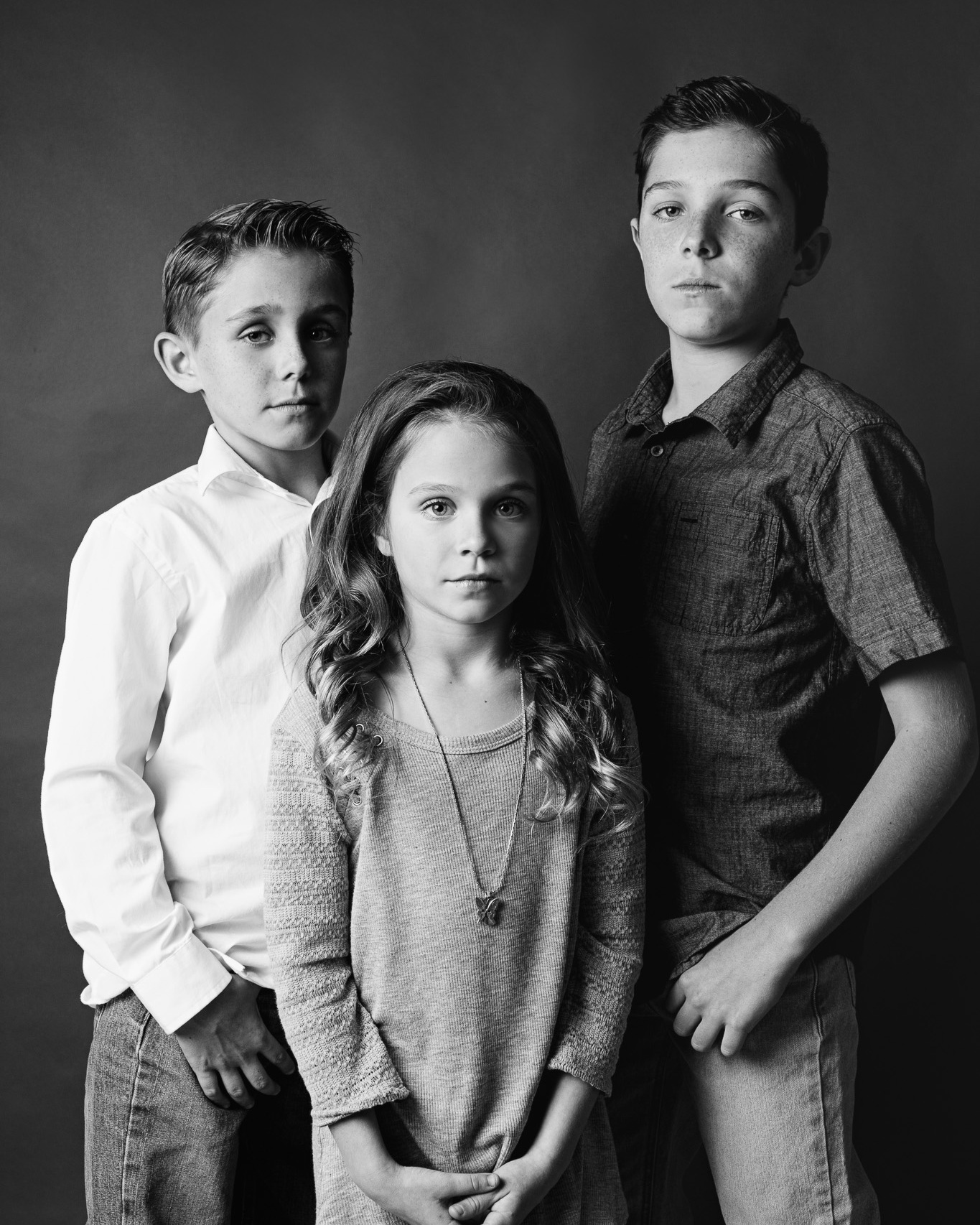 black and white portrait of sibling children in new braunfels photography studio