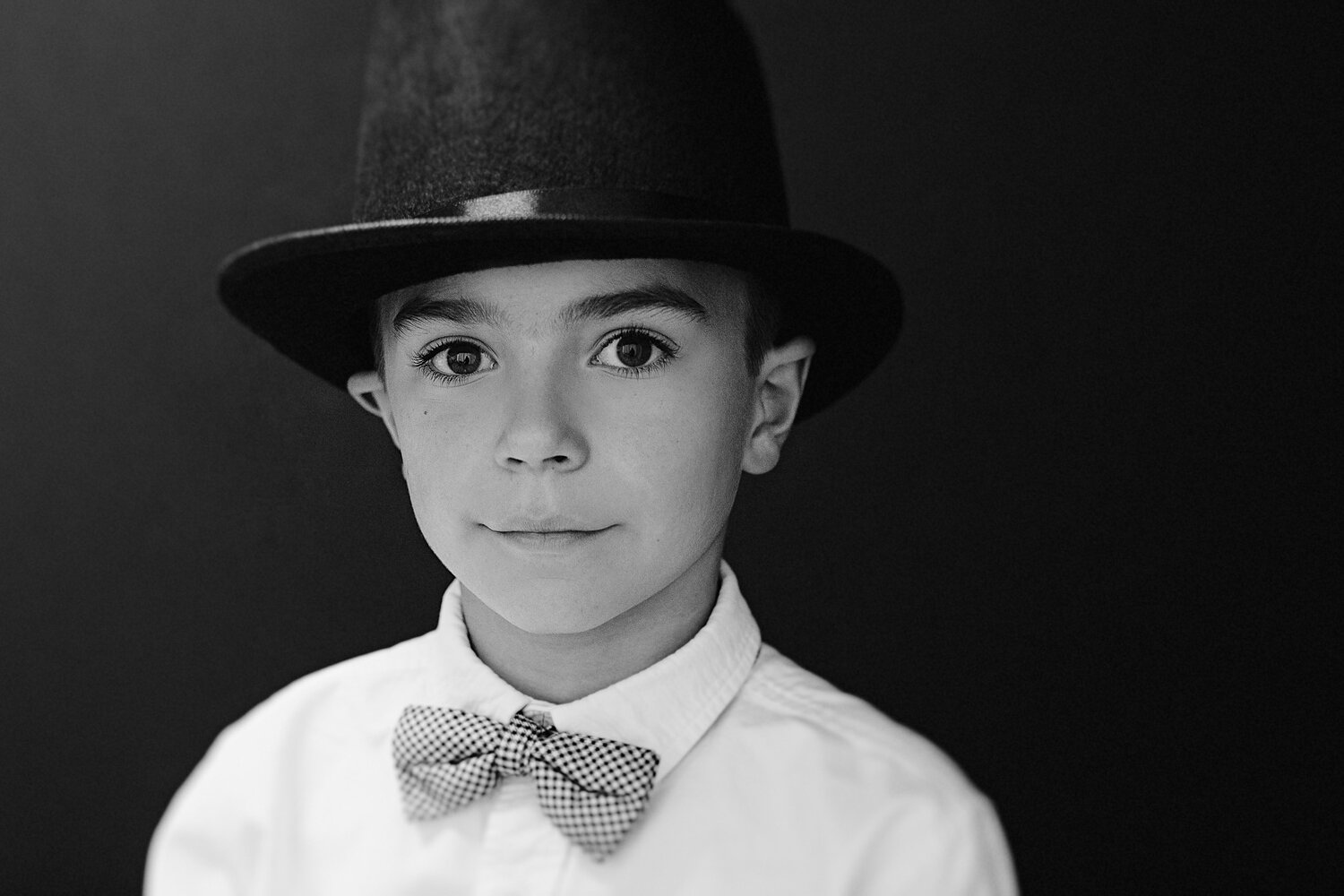 black and white portrait of boy in bowtie and top hat new braunfels photography studio