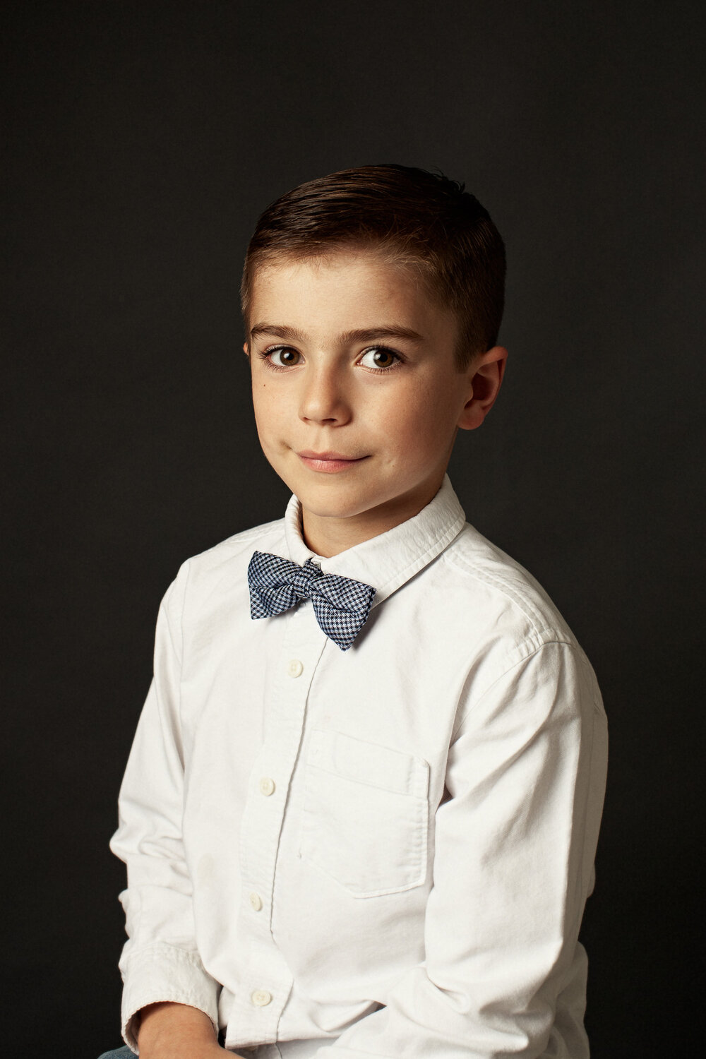 portrait of boy with bowtie sitting new braunfels photography studio