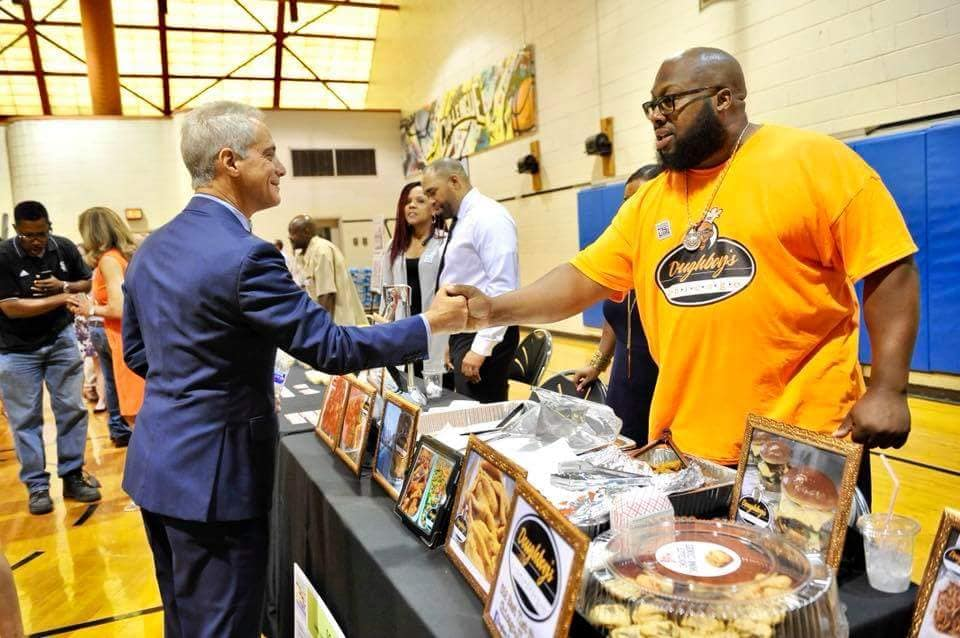 Doughboy Fryison and Mayor Rahm Emanuel at the awards presentation for the Neighborhood Opportunity Fund.