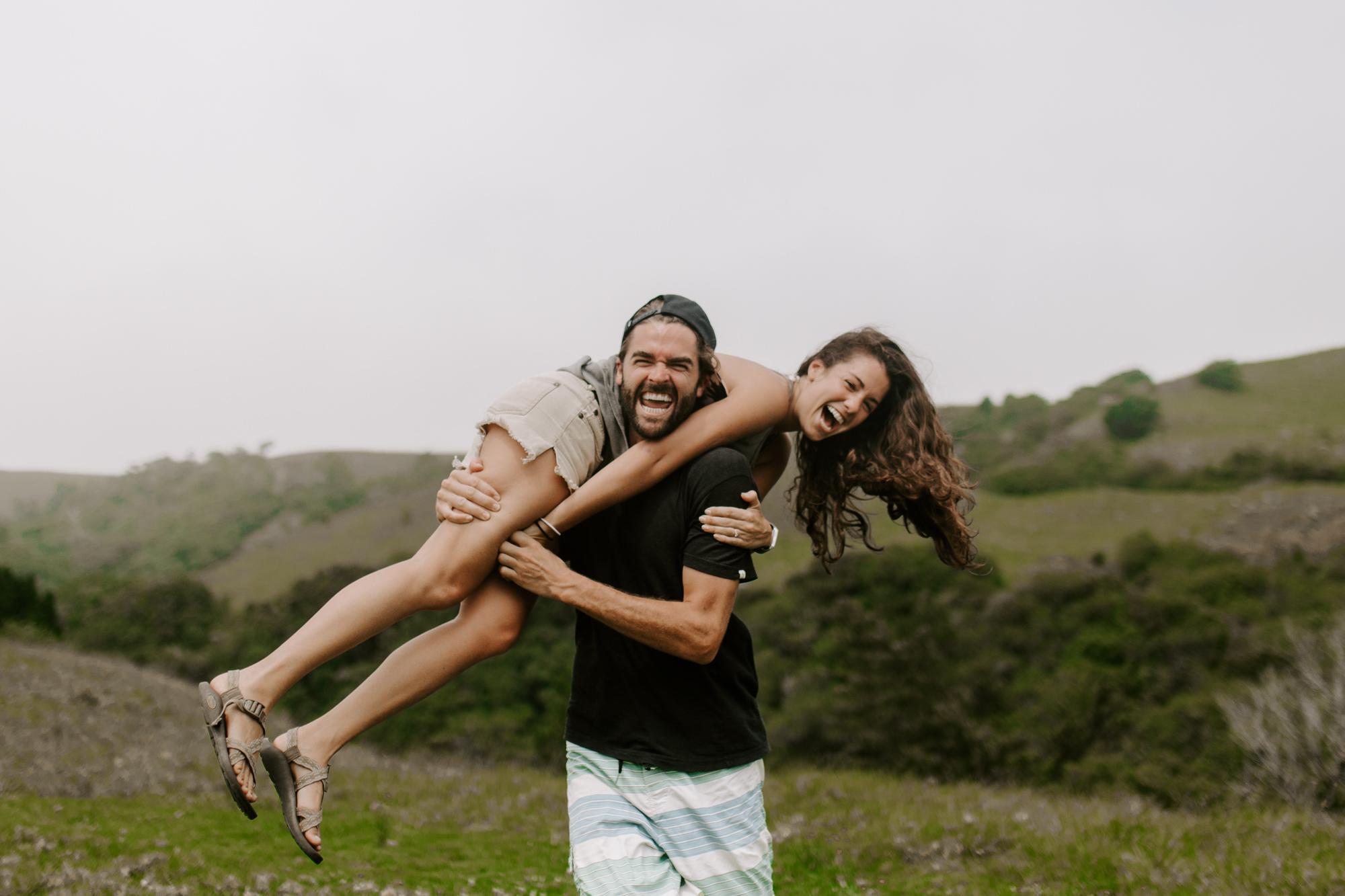 smiling-couple-running-through-waimea-hills-hawaii.jpg