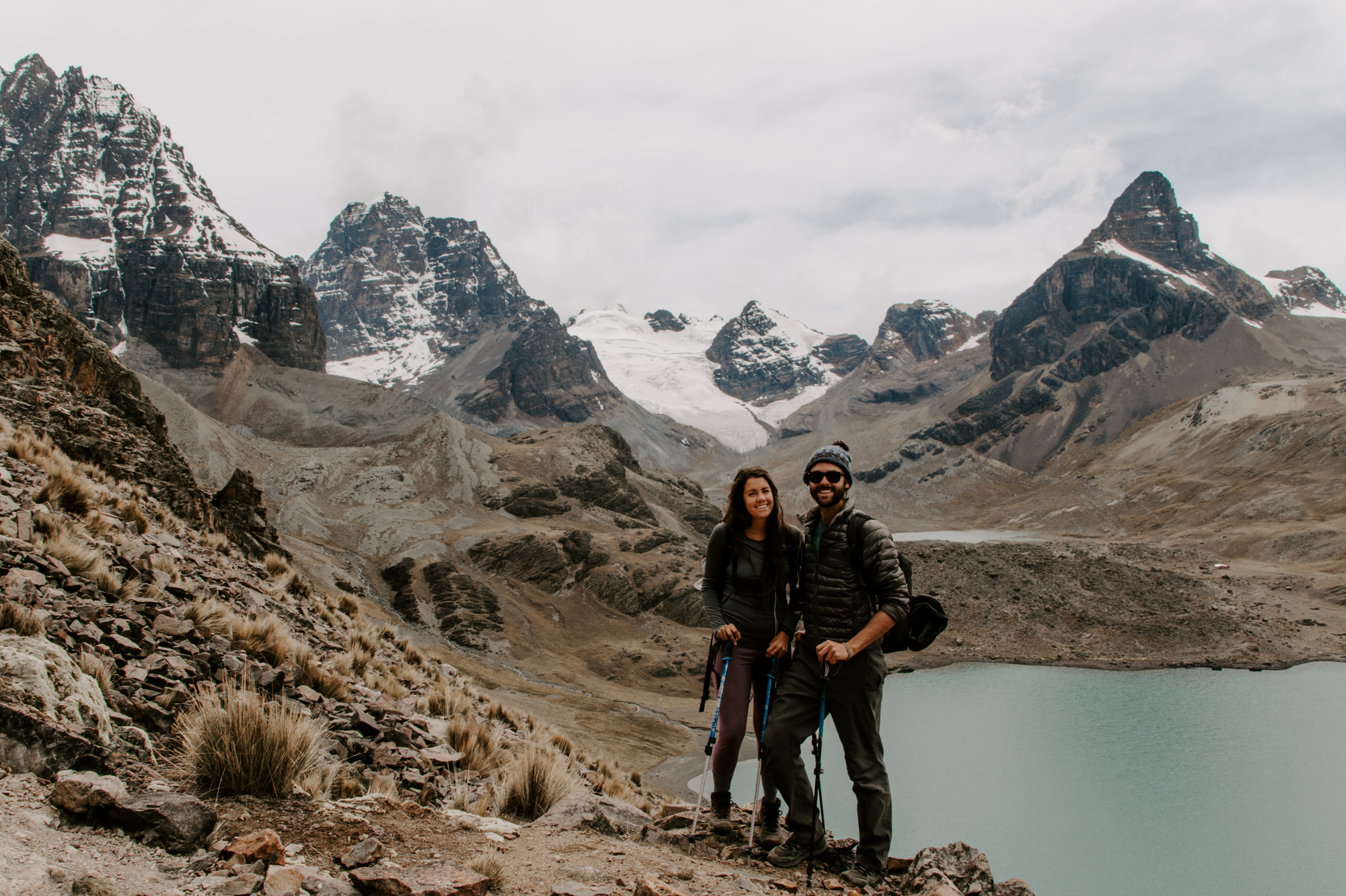 couple-posing-near-water-with-mountains.jpg