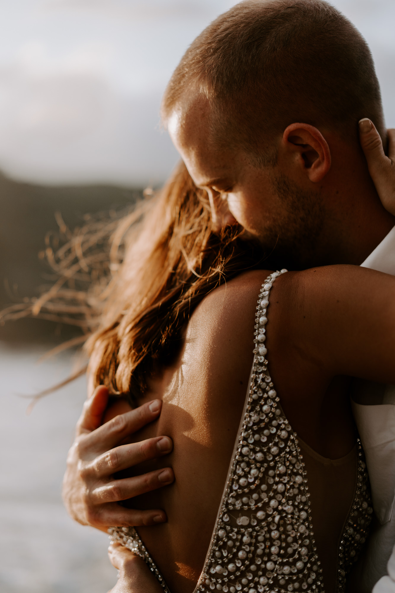 bride-hugging-groom-on-Hawaii-cliffsjpg