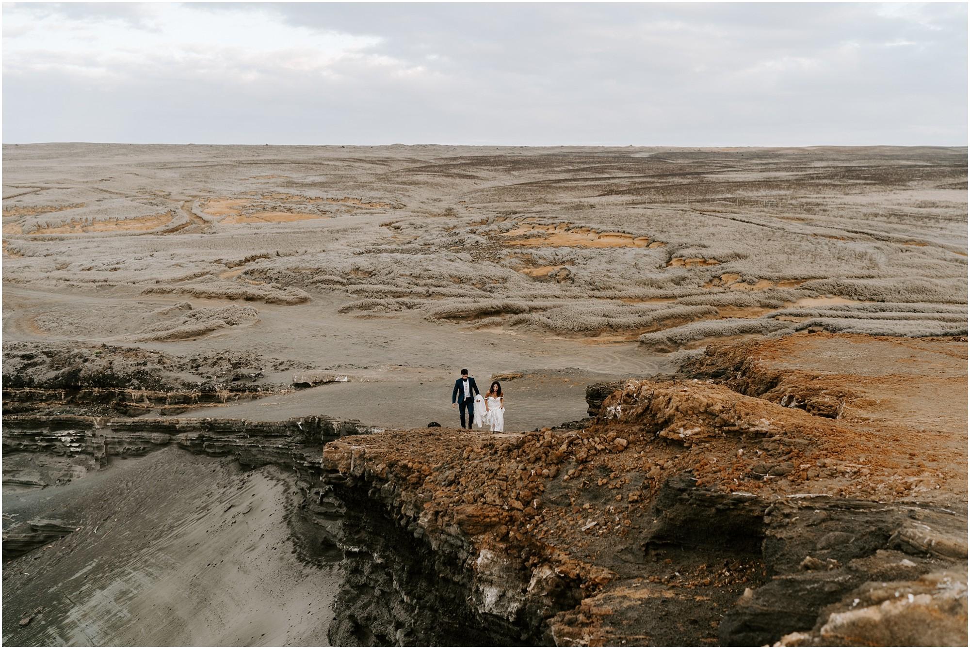 couple-walking-green-sands-beach-hawaii.jpg