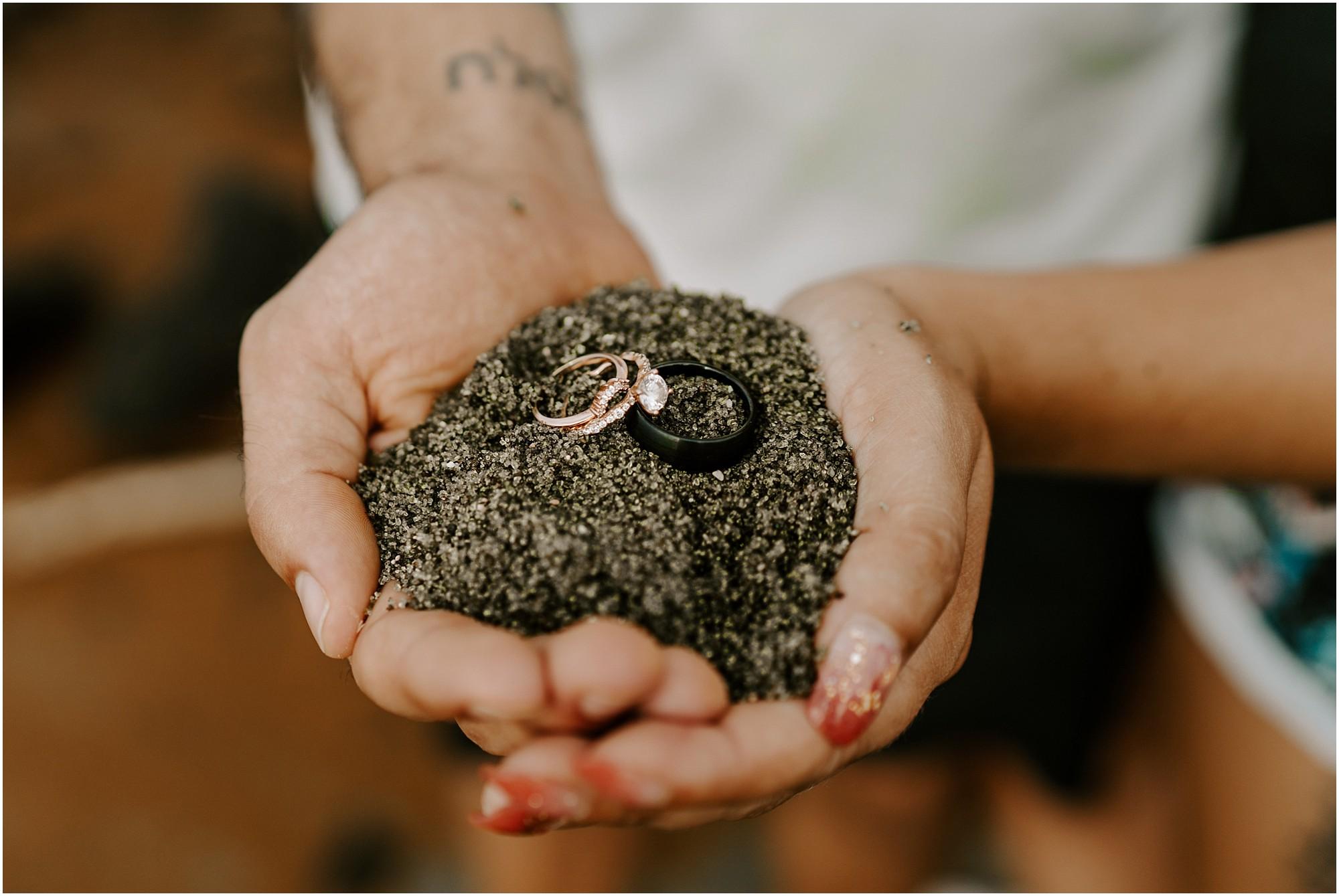 couple-holding-green-sand-big-island.jpg