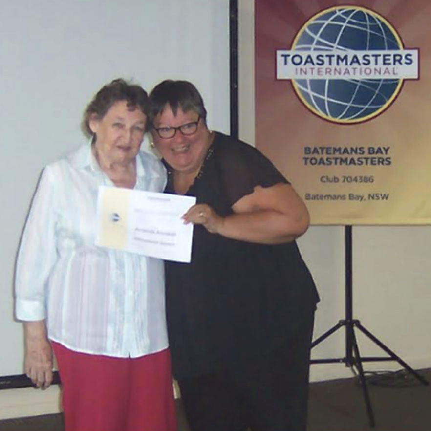 Amanda is presented with her certificate by Margaret Perger, President of Moruya Toastmasters Club