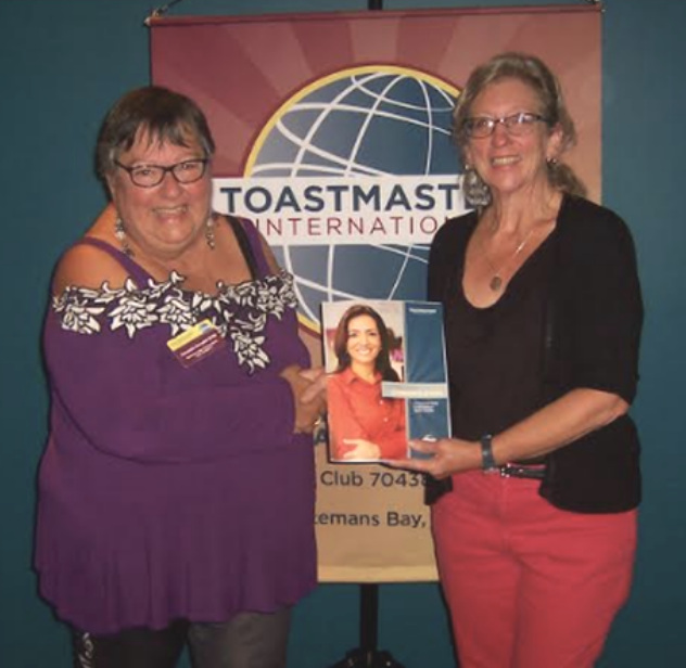 Barbara (right) is presented with her first Toastmasters manual by VP Membership Amanda Annabel